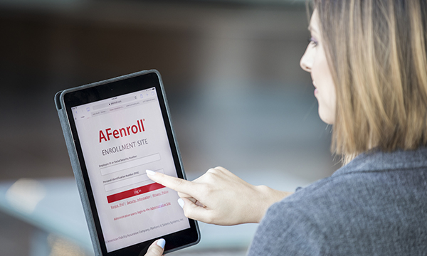 Woman looking at tablet with AFenroll screen